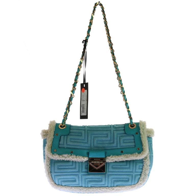 f3e626828a GIANNI VERSACE COUTURE blue quilted shearling leather shoulder bag For Sale  at 1stdibs