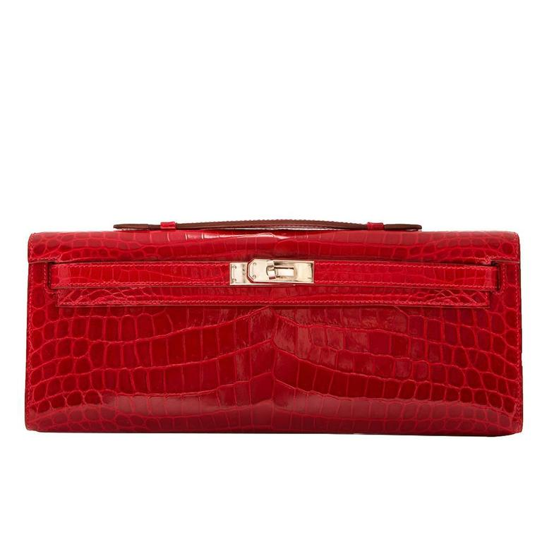 Hermes Braise Red Kelly Cut in shiny Porosus Crocodile withsilver​ hardware. 1