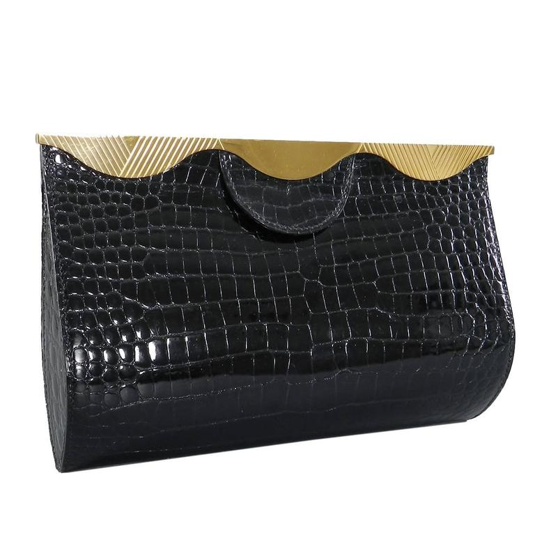 Hermes Vintage 1998 Limited Edition Black Crocodile Clutch with Gold Frame For Sale