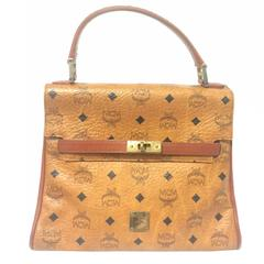 Vintage MCM Kelly style bag with golden logo plate in classic brown monogram.