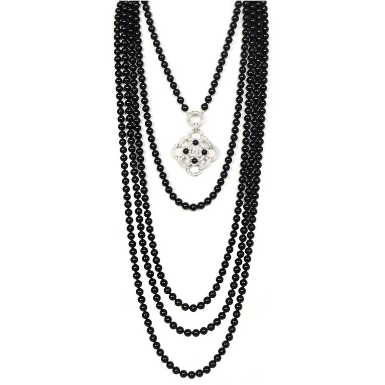 Chanel 2016 Black Beaded 5 Strand Necklace w/ Crystal CC Camellia For Sale