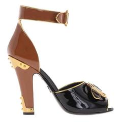 Prada NEW & SOLD OUT Black Cognac Gold Metal Patent Buckle Heels in Box