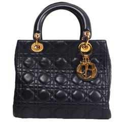 Christian Dior D bag in Navy leather.