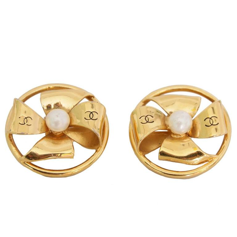 A Pair of 1980s Chanel Gold Toned Clip-on Earrings 1