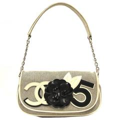 1990s Chanel Black and White Canvas Clutch