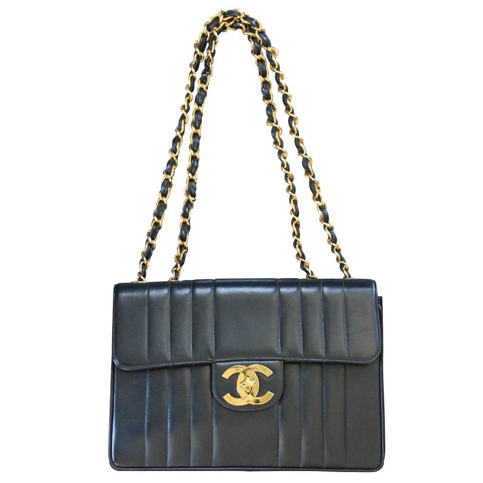 cf39a3aaf2f1 Chanel Black Quilted Lambskin Vertical Maxi Flap GHW Vintage Handbag at  1stdibs