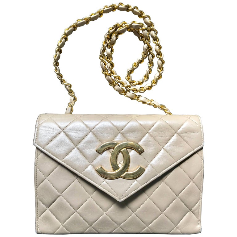 Vintage CHANEL beige lambskin chain shoulder purse with large CC beak tip flap.