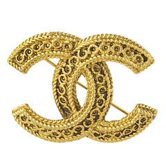 Chanel Gold Etrsucan CC Logo Brooch
