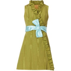 Green silk ruffle cocktail dress with blue bow, circa 1967