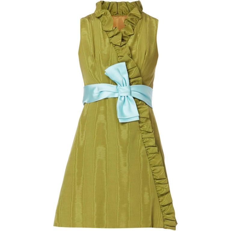 Green silk ruffle cocktail dress with blue bow, circa 1967