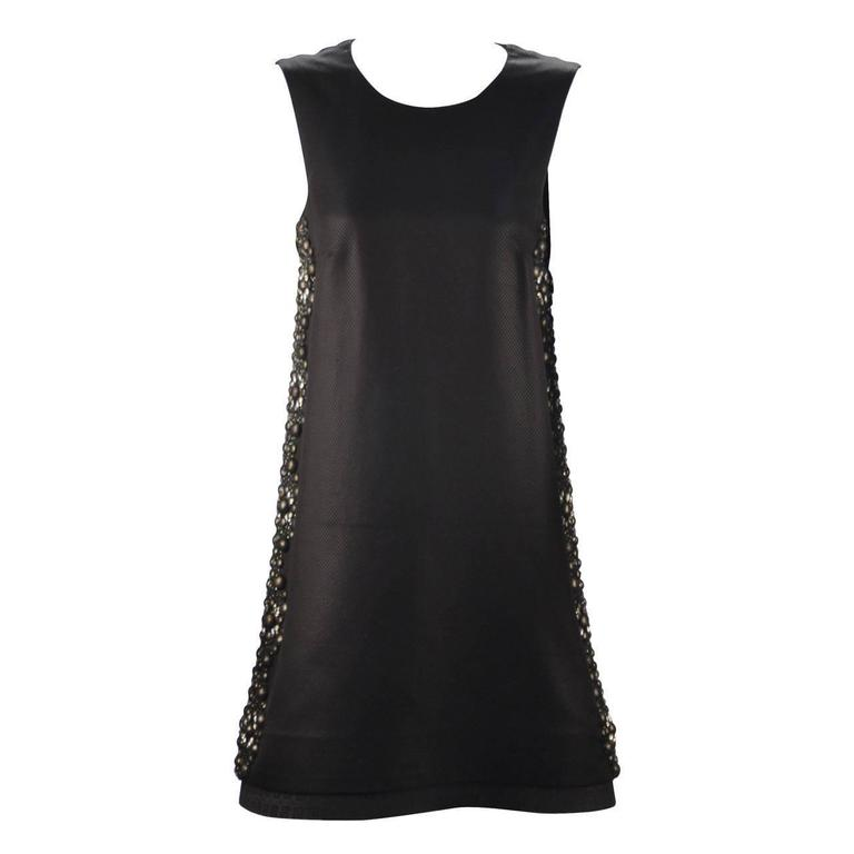 This A-Line black beauty is strikingly edgy - a Gucci masterpiece. The embellishments along the sides add glamour and interest. At the same time adding class and sophistication. Diamond crystals sparkle and round beads are covered with black tulle