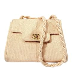 Chanel Vintage beige rope purse with gold logo double CC closure