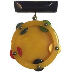 1930s Multicolored Bakelite Figural Tambourine Dangling from Bar Brooch Pin