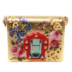 Dolce & Gabbana floral print gold clutch box