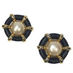 CHANEL Clip-on Earrings in Black Faux Leather, Gilt Metal and Pearl