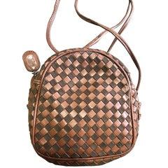 Vintage Valentino Garavani brown intrecciato mini pouch style shoulder bag.