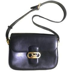 Vintage Celine black leather classic shoulder bag with golden logo closure.