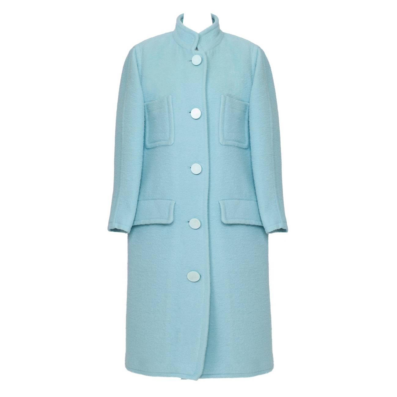 For Sale on 1stdibs - Courreges Baby Blue Wool Coat from 's. This iconic coat featuring oversized patch pockets and sewn in pockets with flap with center front button closure.