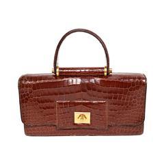 Hermes crocodile top handle bag with geometric hardware, 1940s