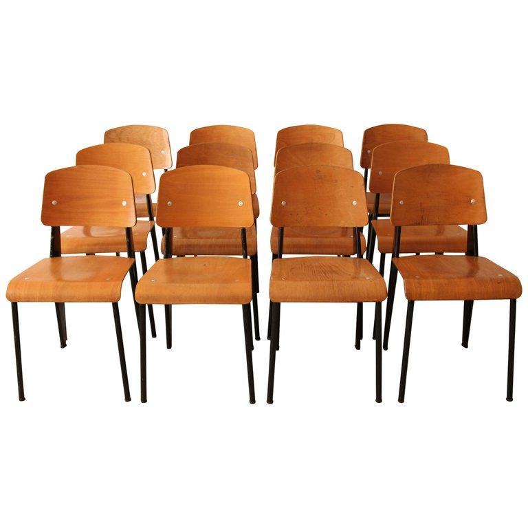 French Jean Prouvé, Monumental Set of 12 'Semi-Metal' Chairs, circa 1950 For Sale