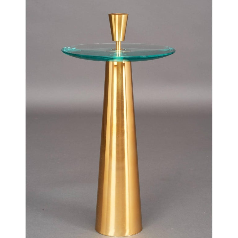 Roberto Rida (b. 1943). Sculptural pair of side tables with massive ground-glass top with convex underside, polished tapered brass base and finial. Signed. Italy, 2016. Tables are priced and sold individually Limited edition, exclusive to L'Art