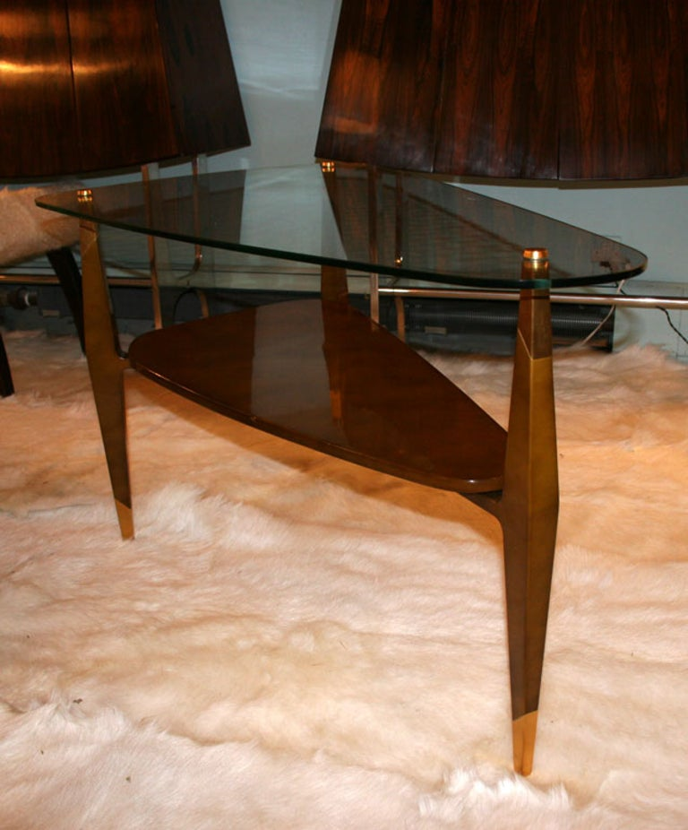 Spectacular table by Raphael from the same commission as the chest. Also finished in Beka lacquer this table as a spectacular design and details. The delicate top is actually a very resilient tempered glass. Signed on a brass plate to the bottom.