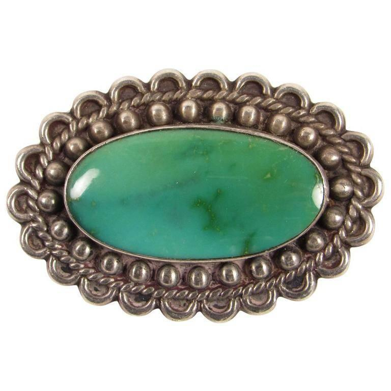 20th Century Navajo Turquoise Sterling Silver Brooch For Sale