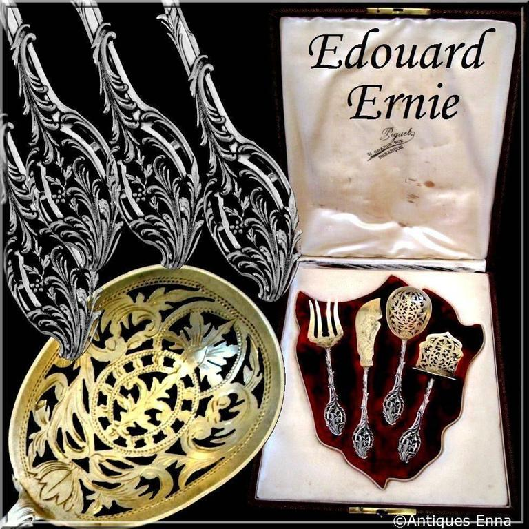 Ernie French all sterling silver 18K Gold dessert Hors D'oeuvre set of four piece with box.  A set of truly exceptional quality, for the richness of its decoration, its form and sculpting. The set includes a knife, a pierced server, a fork and