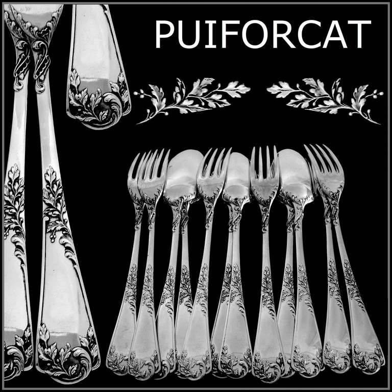 Puiforcat French sterling silver dessert entremet flatware set 12 pieces Rococo.  Handles have fantastic decoration in the Rococo style. Model called Louis XV, Foliate in the catalog of the Maison Puiforcat. No monograms.  To complete this set.