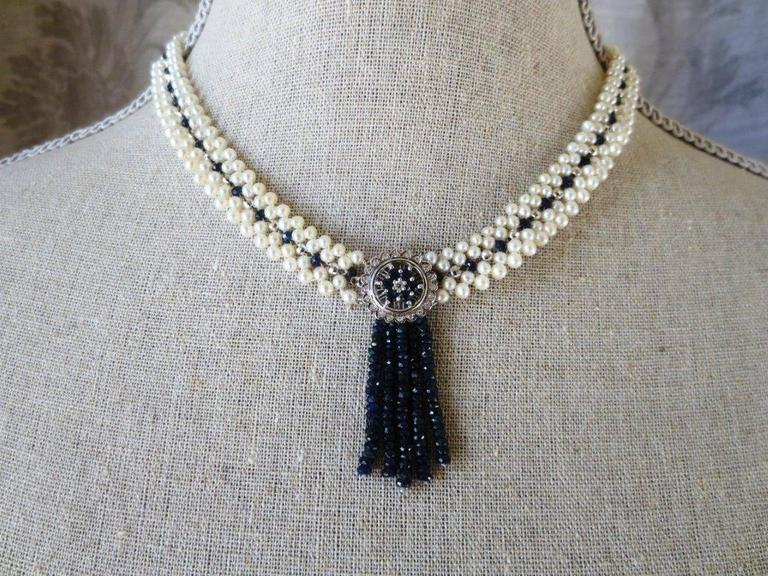 Graceful necklace by Marina J. The cultured white pearls range in size from 3 to 3.5 mm and are arranged in two double rows of pearls with sapphire and white gold beads interspersed between them.   The centerpiece of this lovely necklace is