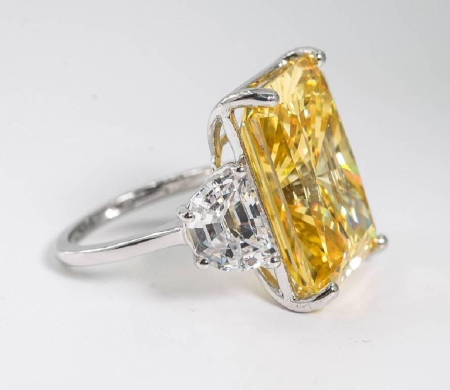 Magnificent Faux Canary Yellow 25 Carat Radiant Cut Diamond Ring For Sale at