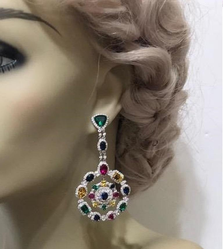 Magnificent Costume Jewelry multi -color gem wreath chandelier circle earrings set with different cut synthetic emeralds, rubies, sapphires, yellow and white diamonds set in rhodium sterling. Post fitting 3 inches long by 1.50 inches wide