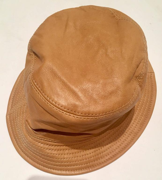 Iconic Burberry check and camel leather bucket hat. Original manufacturer  tag intact d86a9ad8cbb