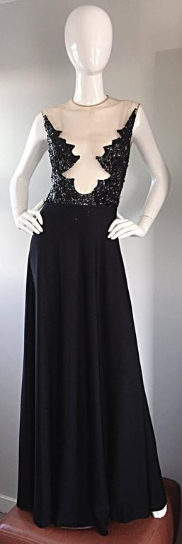 Absolutely incredible RARE 70s MR. BLACKWELL black vintage full length dress! Nude Illusion bodice, with strategically hand-sewn sequins, to cover just the right amount. Full black jersey skirt, with nude silk mesh on bodice, hand encrusted with