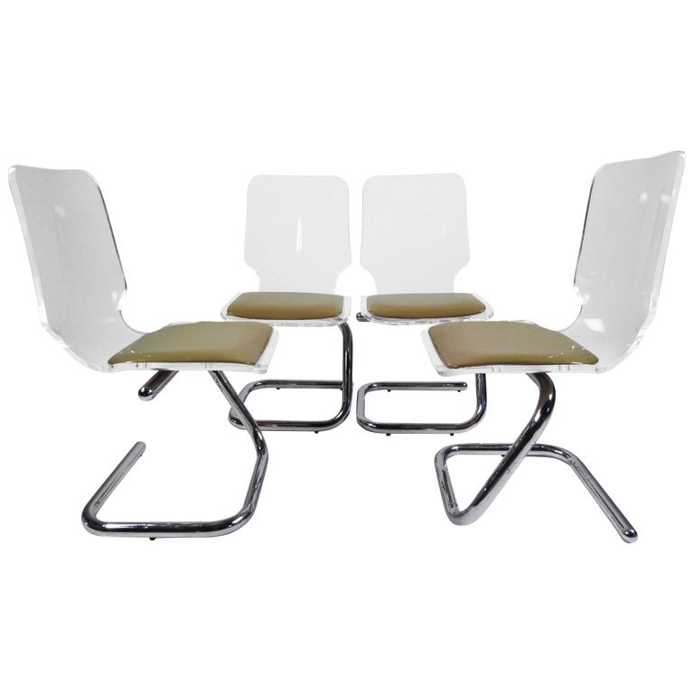 Beau Mid Century Modern Lucite And Chrome Dining Chairs By Luigi Bardini