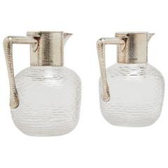 Pair of Christopher Dresser Glass Pitchers