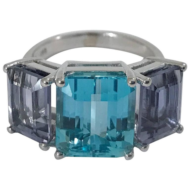 18kt White Gold Three Stone Emerald Cut Ring with Blue Topaz and Iolite For Sale