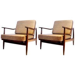 Pair of 1950s Danish modern walnut finish club chairs by Scandia