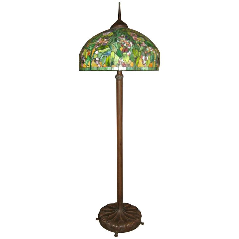 Tiffany style stained glass and bronze floor lamp at 1stdibs for Tiffany style vase floor lamp