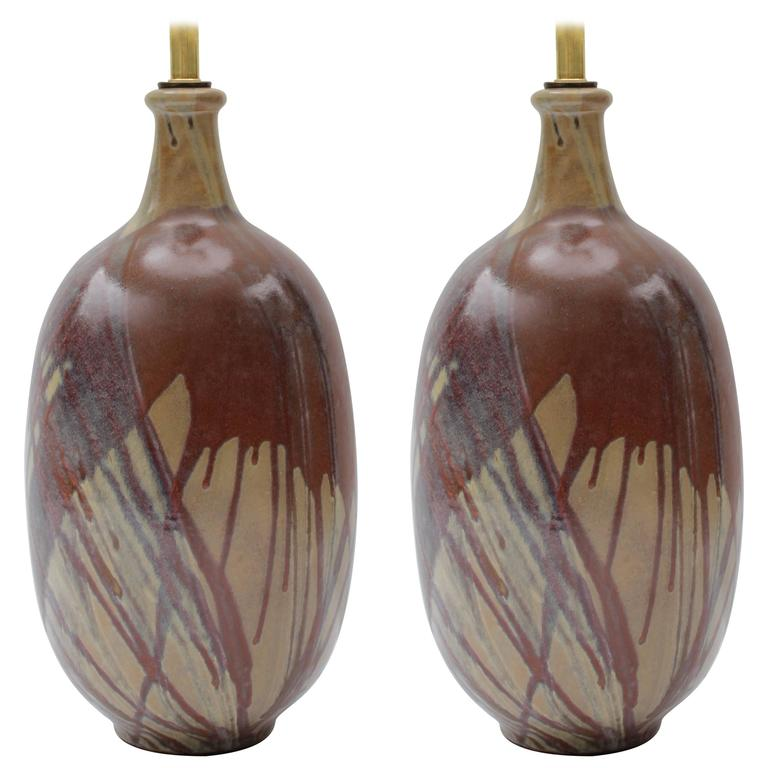 Great pair of California terra cotta drip glaze lamps. New double cluster, Twist Cord. All new wiring.