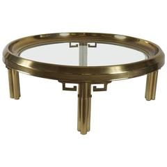 1970's mastercraft round brass coffee table with greek key detail
