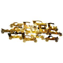 Whimsical and unique large Antique cars metal wall hanging in brass