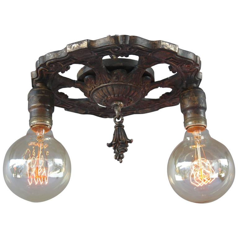 this antique 1920s two light ceiling mount light fixture is no longer