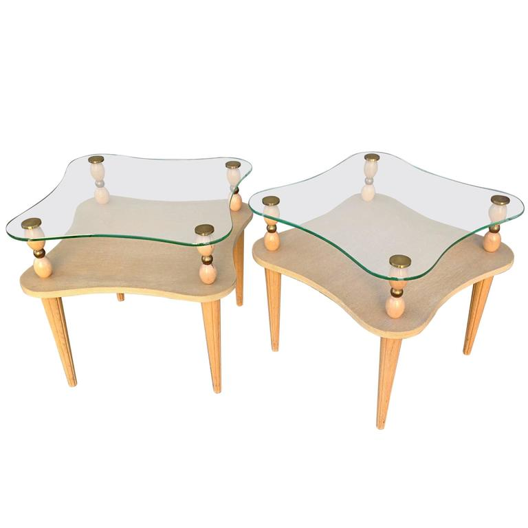 Sculptural Two-Tier Glass Top Tables in the Manner of Gilbert Rohde