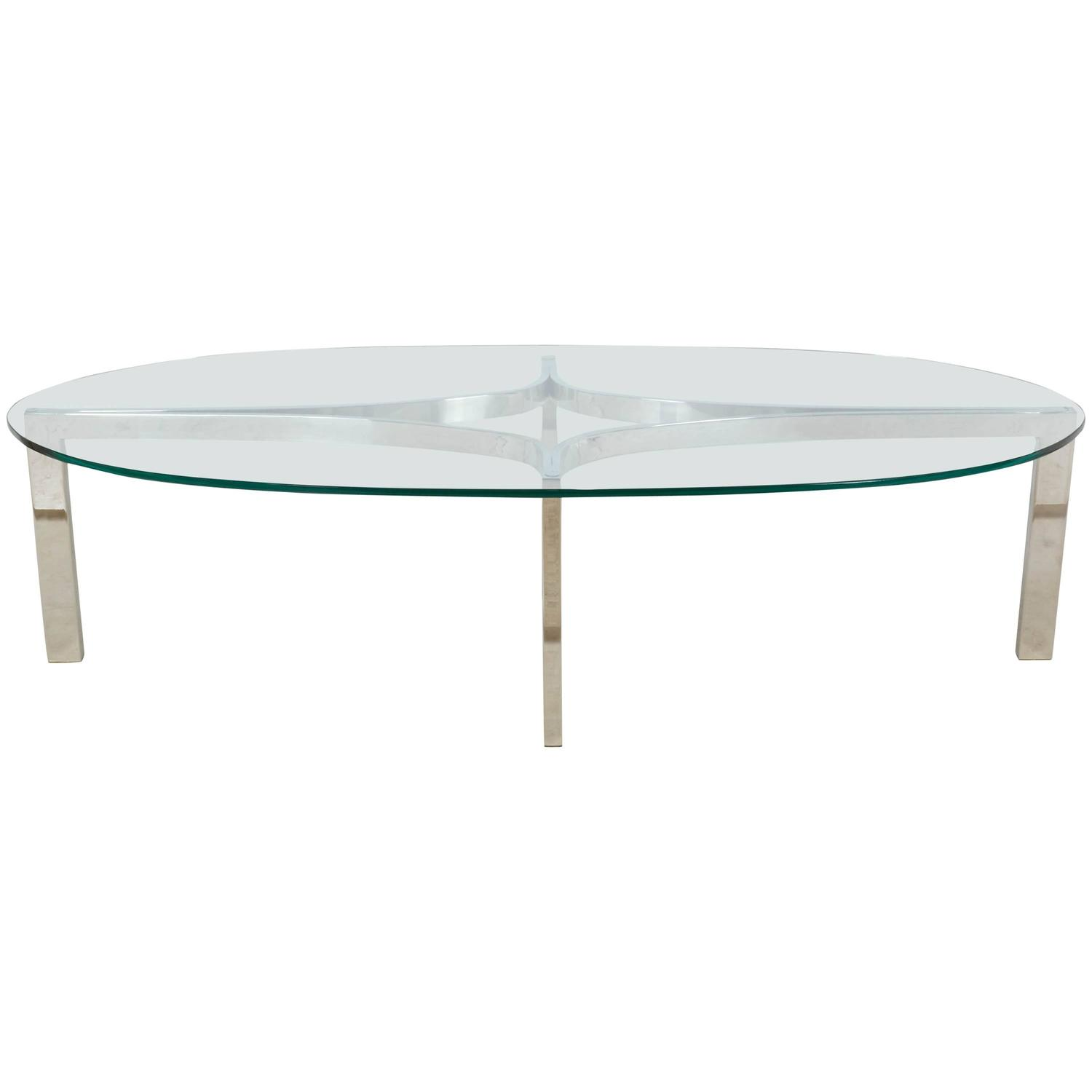 Chrome and glass sculptural oval coffee table at 1stdibs Glass oval coffee tables