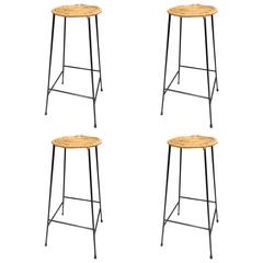 Set of Four Iron and Rattan Midcentury Bar Stools