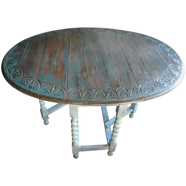 19th century oak carved top, drop-leaf table with gate-leg and