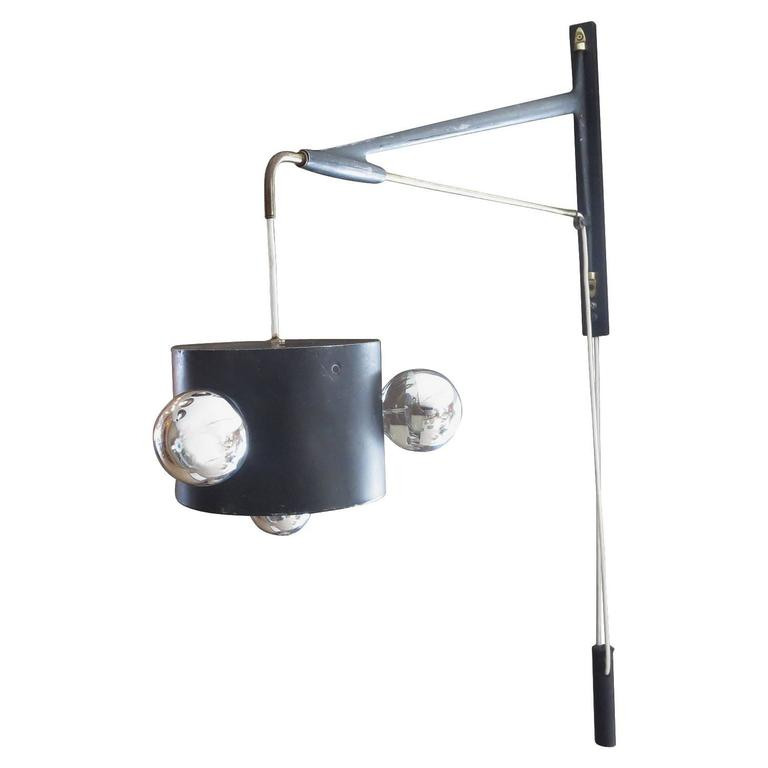 Swing Arm Wall Sconce by Maison Arlus