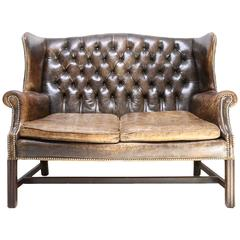 Chesterfield wingback tufted leather sofa