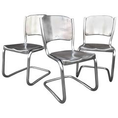 Two Sets of Four Tubular Brushed Steel Dining Chairs